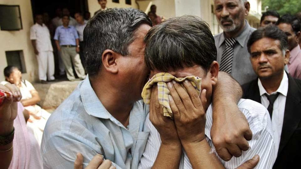Relatives of the convicts in 2002 Naroda Patiya massacre case in tears outside the court after the pronouncement of sentence in Ahmedabad, in 2012.