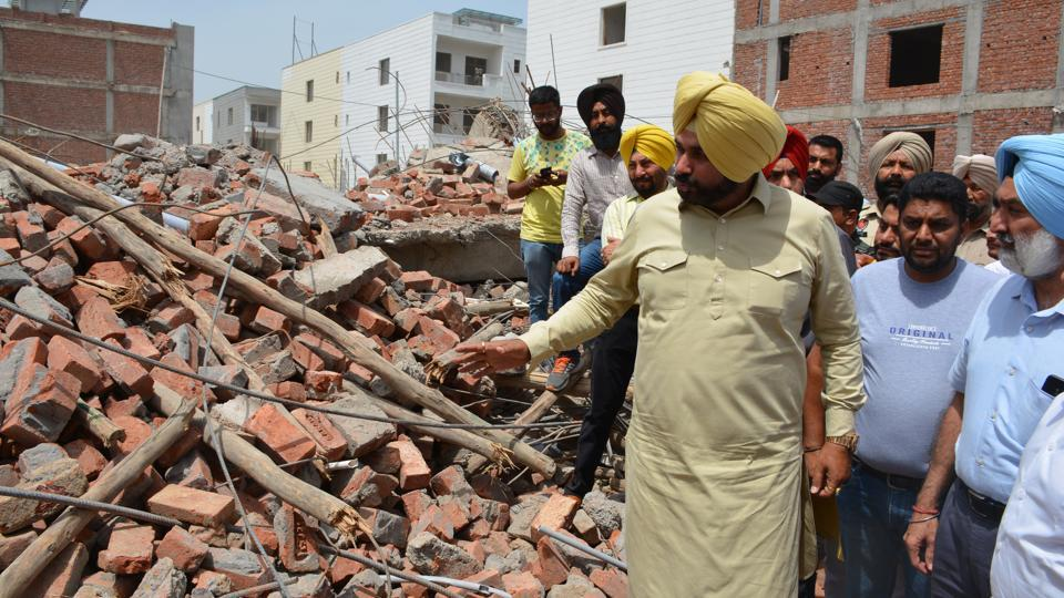 Punjab local bodies minister Navjot Singh Sidhu at the building collapse site at Peer Muchalla in Zirakpur on Thursday.