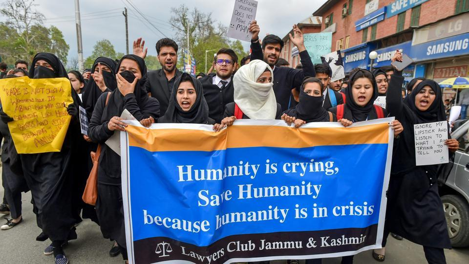 Lawyers and students hold placards during a protest demanding justice for the 8-year-old girl who was raped and murdered in Kathua, Srinagar, April 18, 2018