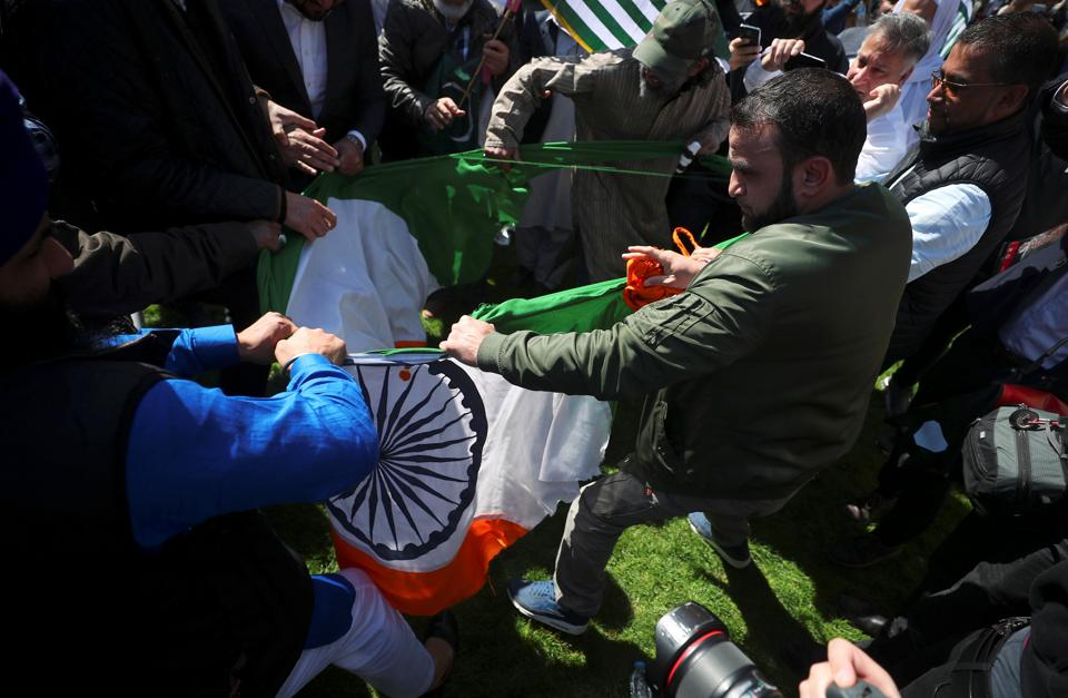 "India on Friday expressed ""deep anguish"" at tricolour being pulled down, torn and stamped on during Prime Minister Narendra Modi's visit in London and said it expects the UK government to take action, including legal measures, against those responsible. Britain officially apologised on Thursday for the incident that prompted a strong protest from the Indian high commission. (Hannah McKay / REUTERS)"