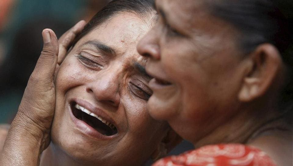 Relatives of those convicted in the Naroda Patiya riots case break down outside the court on the day of pronouncement of sentence in the case, in Ahmedabad in August 2012.