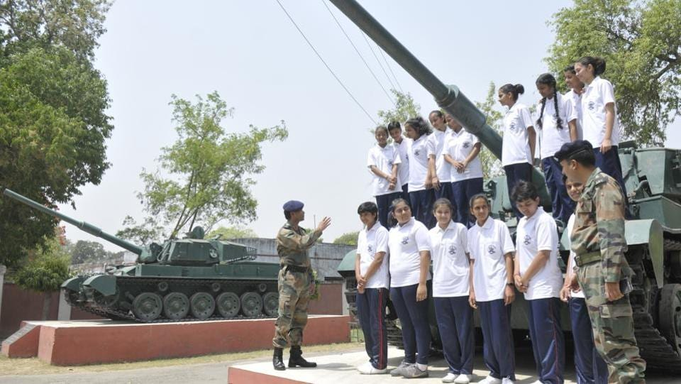With beaming smiles and lit-up eyes, the girls did not miss the opportunity to climb on the two Vijayanta tanks kept as trophies at the entrance of the 57-year-old institution, the first army school to be opened in the country. Later, 27 other such schools were established across India. (Deepak Gupta/HT Photo)