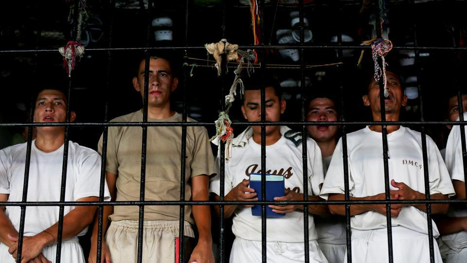 Evangelical Christianity has grown rapidly in Central America in the past decade, colouring local politics. Dozens of lawmakers embrace it, defending hardline positions against gay rights and abortion. The fervor has spilled into jails, where it is welcomed by officials who sense its potential for reforming ex-gangsters.  (Jose Cabezas / REUTERS)