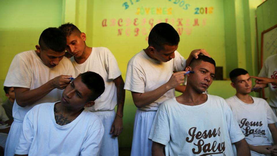 Inmate members of the Final Trompeta (The Final Trumpet) church learn how to cut hair. President Salvador Sanchez Ceren's government plans to use Gotera as a model of religious rehabilitation it hopes can be replicated. Two years ago the prison, located about 166 km east of capital San Salvador, was almost entirely home to active gang members. (Jose Cabezas / REUTERS)