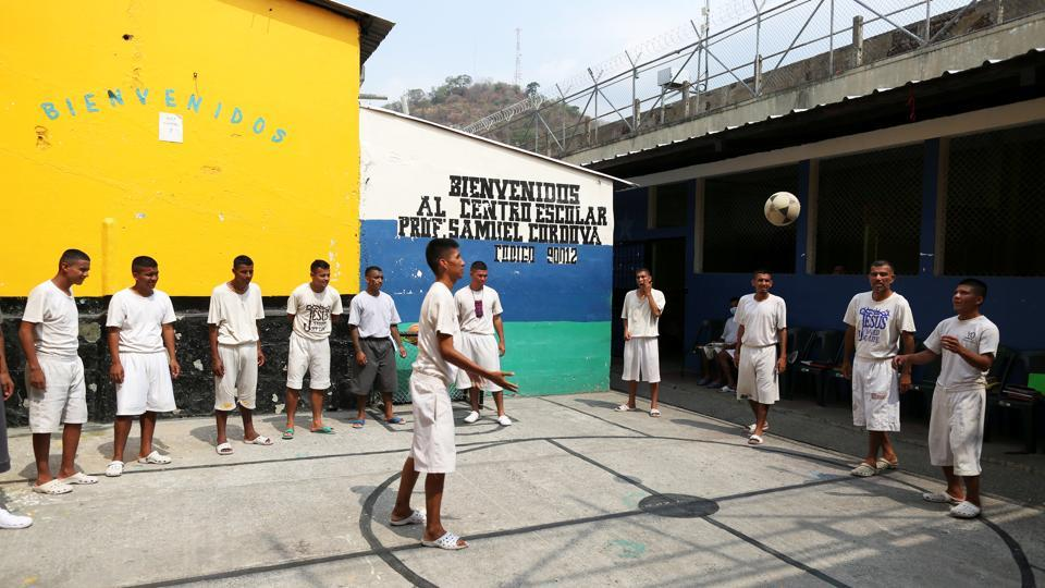 Members of the Final Trompeta church play ball at prison. Now, the majority of the approximately 1,500 inmates want to find redemption, says prison director Oscar Benavides. The conversions show that it is possible to rehabilitate those in the MS-13 or other gangs, says Security Minister Mauricio Ramirez, dismissing criticisms that the government should do more. (Jose Cabezas / REUTERS)