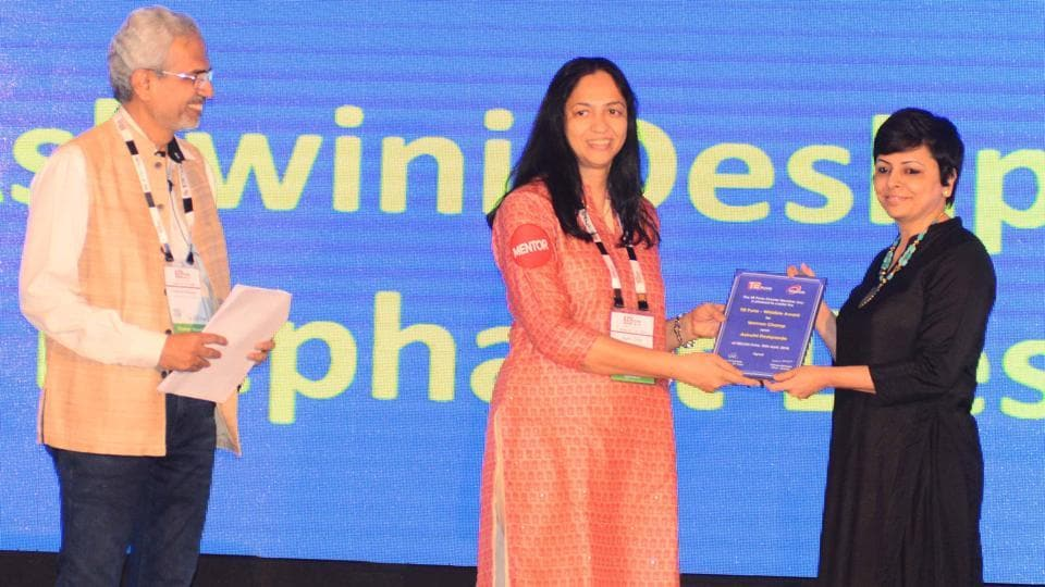 Sujata Tilak, managing director, Ascent Intellimation Pvt Ltd, (center) presented the Woman Champ award to Ashwini Deshpande, founder, Elephant Design, ex-global trustee at TiECon Pune 2018 awards function on Friday.   (SHANKAR NARAYAN/HT PHOTO)