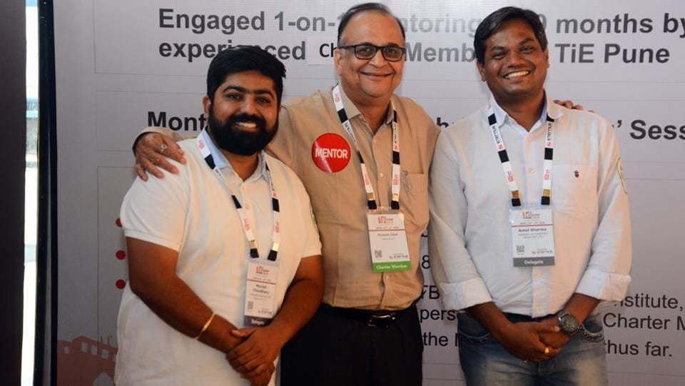 Manish Choudhary (left) and Amol Sharma (extreme right) with their mentor Hemant Jalan, who were a part of nurture program at the TiECon Annual Entrepreneurship Awards function. (SHANKAR NARYAN/HT PHOTO)