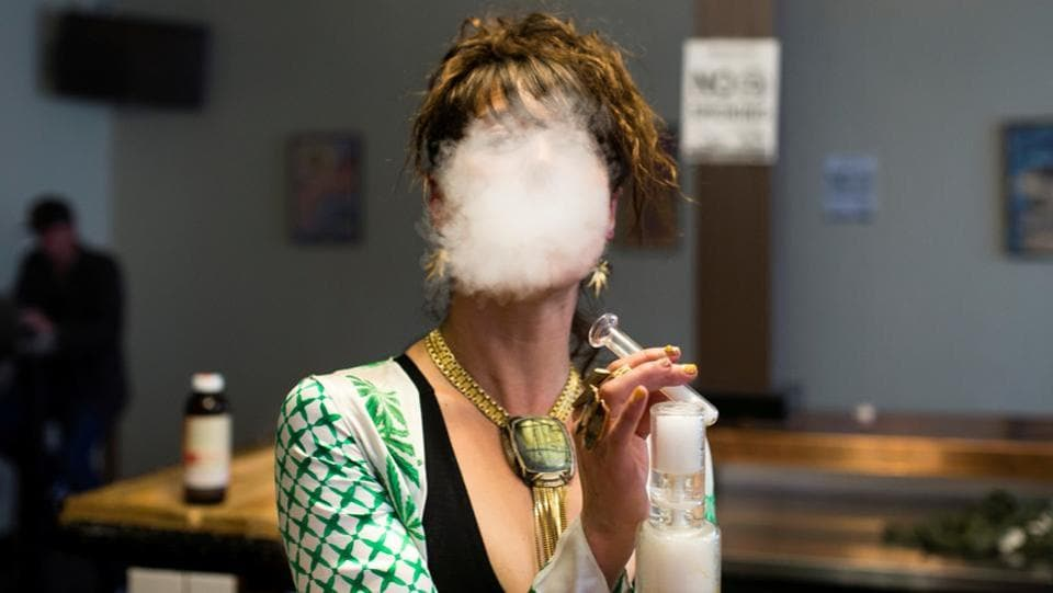 Elise McRoberts exhales after using a full spectrum oil vaporizer at the new Magnolia cannabis vape lounge on the first '4/20' since the sale of recreational marijuana became legal on January 1, in Oakland, California on April 20, 2018. (Elijah Nouvelage / REUTERS)