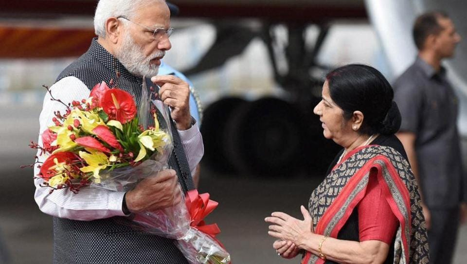 Prime Minister Narendra Modi being greeted by the external affairs minister Sushma Swaraj on his return to India after a three-nation tour, in New Delhi on Saturday. Swaraj left for China to participate in the SCO meet.