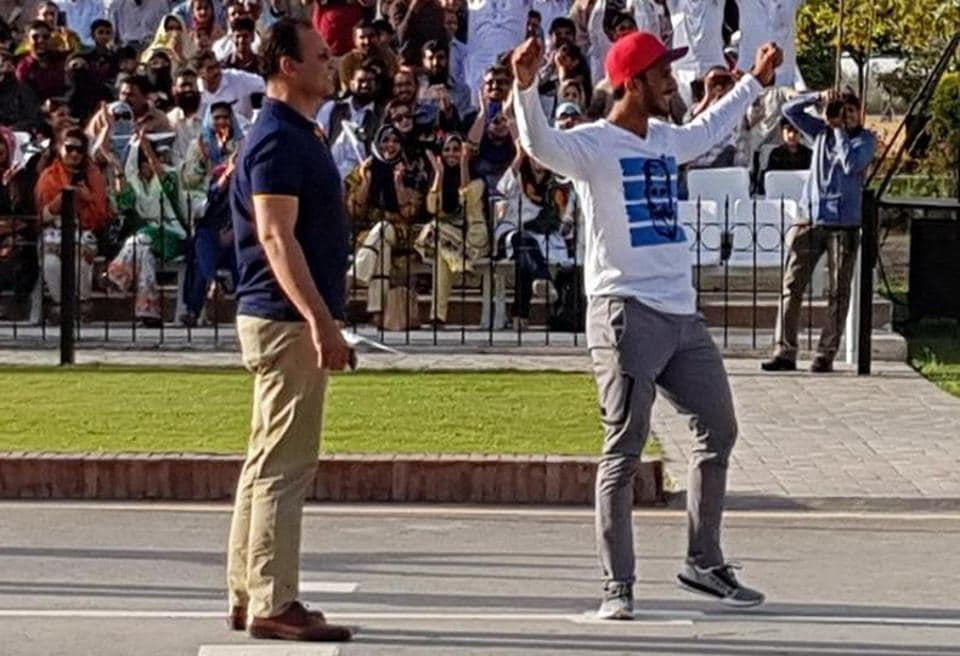 Pakistan cricketer Hasan Ali was seen showing off his trademark wicket celebration during the flag-lowering ceremony at the Wagah border on Saturday, which infuriated India's Border Security Force officials.