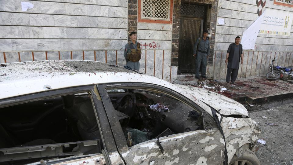 Afghan police stand outside a voter registration centre which was attacked by a suicide bomber in Kabul, Afghanistan.