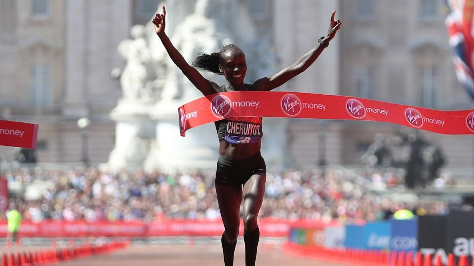 Kenya's Vivian Cheruiyot crosses the finish line to win the elite women's race of the 2018 London Marathon in central London on Sunday.