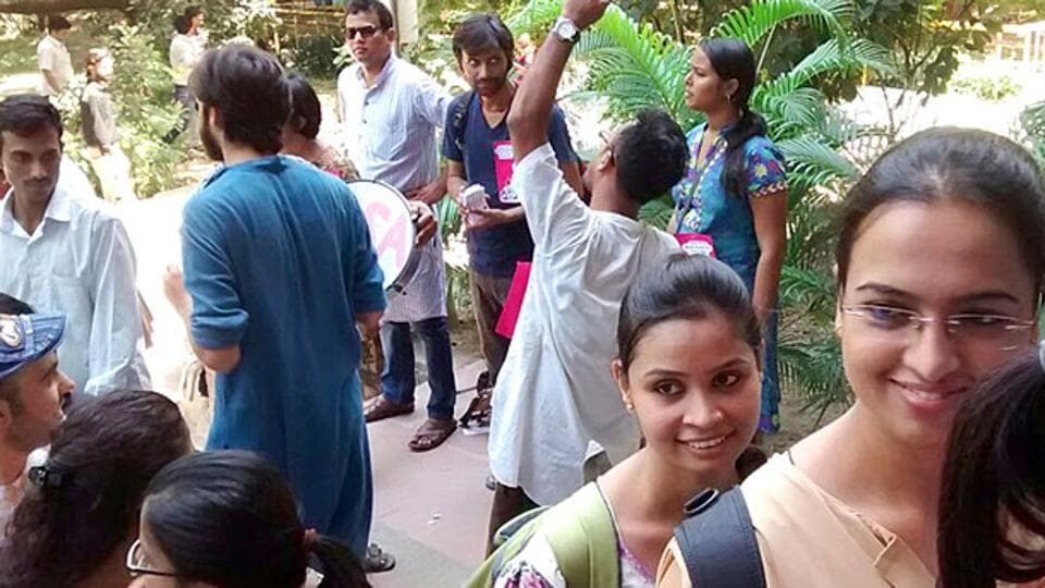 Jawaharlal Nehru University ) students wait to cast their vote in a campus election.