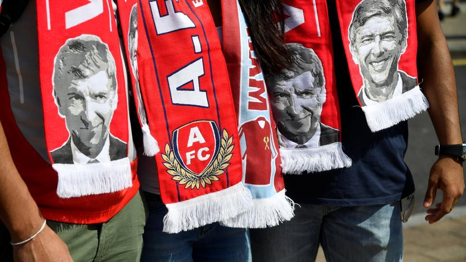 General view of scarves featuring Arsenal manager Arsene Wenger before the match against West Ham United. (REUTERS)