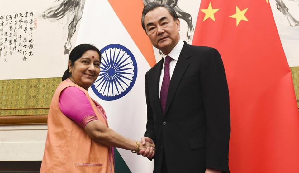 Foreign minister Sushma Swaraj, left, poses with her Chinese counterpart Wang Yi prior to a meeting at the Diaoyutai State Guesthouse in Beijing on April 22, 2018.