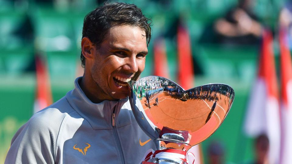 Rafael Nadal holds the trophy as he celebrates his win over Kei Nishikori in the Monte Carlo Masters final.