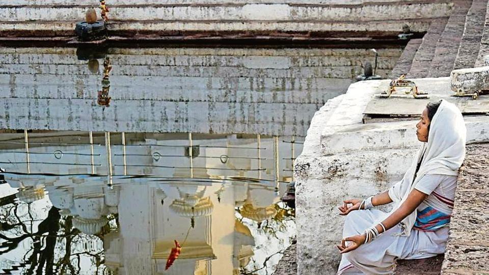 A woman meditates at the Amarkantak source of Narmada river that runs through 47 districts, 1,003 villages, hosts 290 temples, 263 ashrams and 161 dharamshalas on its banks.