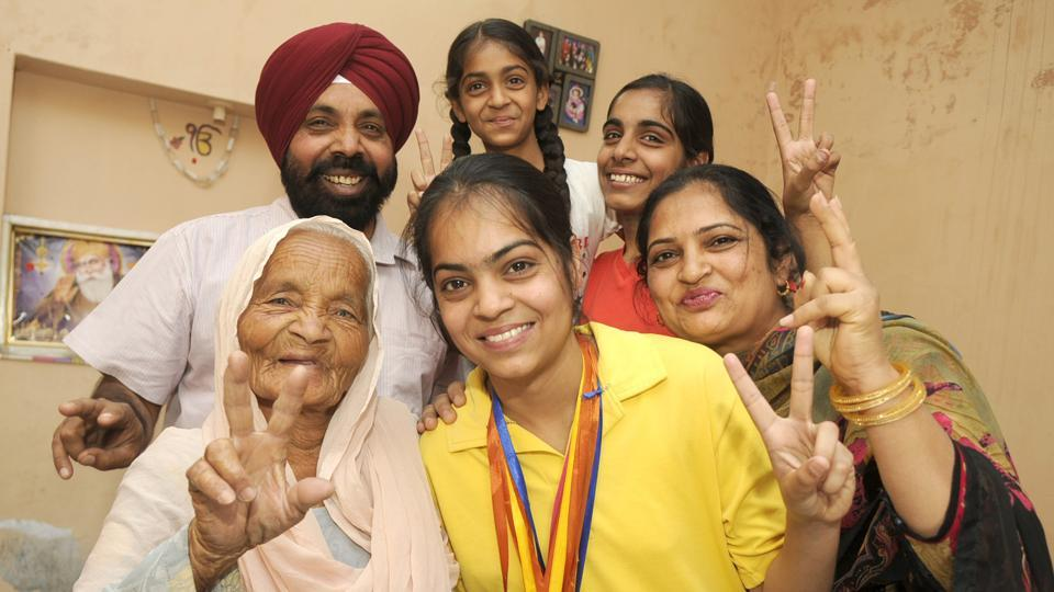 PSEB  Class 12 Patiala district topper Harman Deep Kaur of  celebrates with her family at Shekhupura village in Patiala on Monday. (Bharat Bhushan /HT)