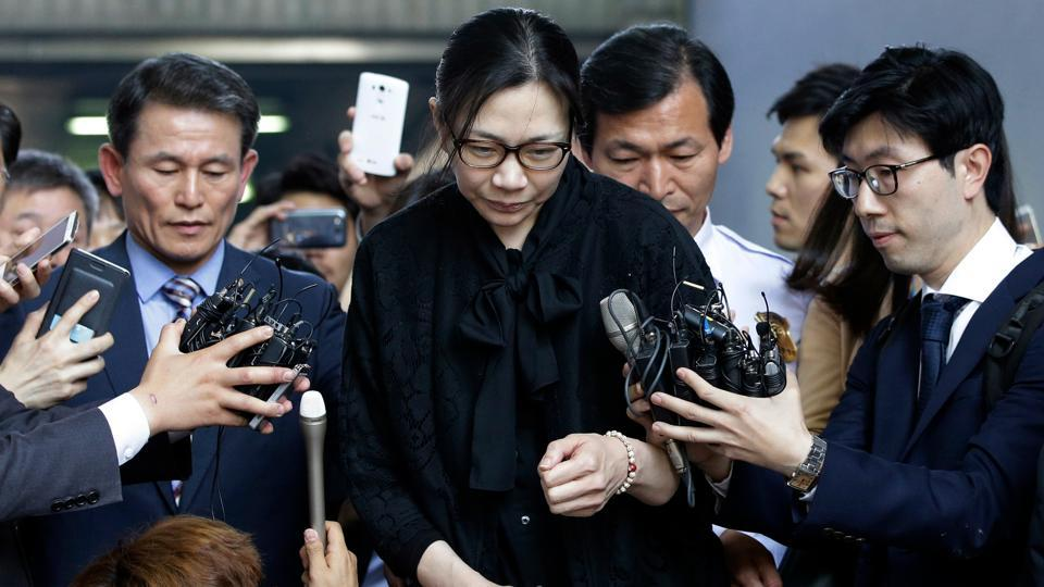 In this May 22, 2015 file photo, former Korean Air executive Cho Hyun-ah, center, is surrounded by reporters as she leaves the Seoul High Court in Seoul, South Korea.