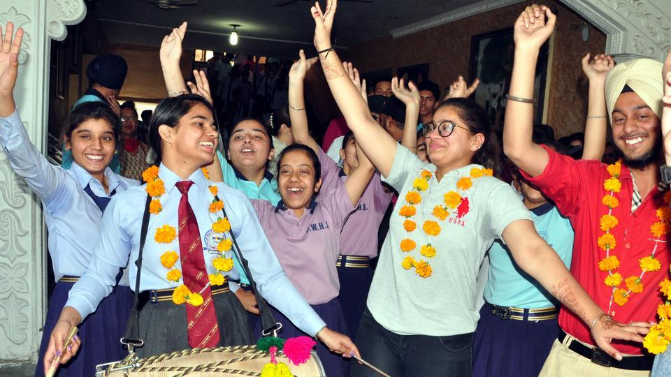 Students of Play Ways Senior Secondary School in jubilant mood after the declaration of the Class 12 results of PSEB, in Patiala. (Bharat Bhushan /HT)