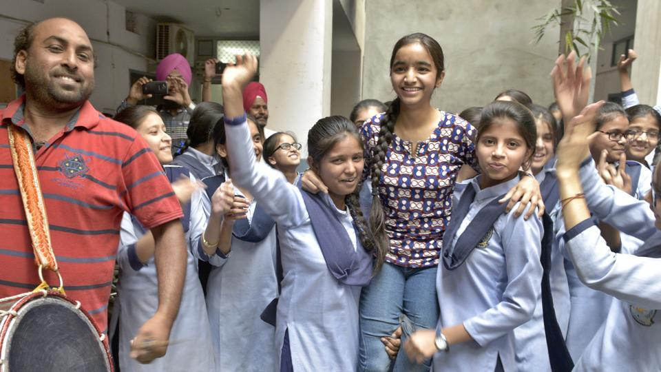 Pooja Joshi (centre) of Ludhiana, who topped the PSEB Class 12 exams with 98% marks in the humanities stream, celebrates with her classmates.