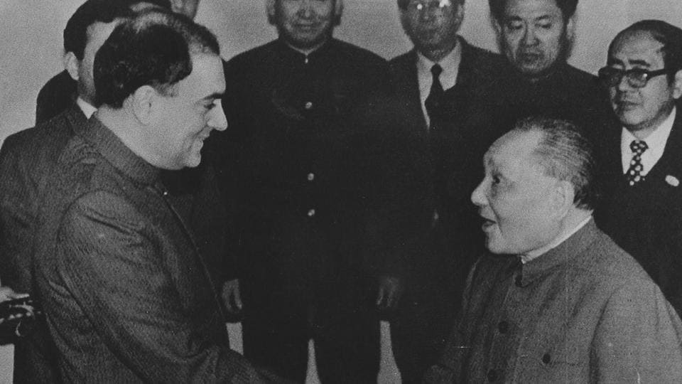 Prime Minister Rajiv Gandhi (L) is greeted by Chinese leader Deng Xiaoping at Beijing's Great Hall of the People on December 22, 1988 .