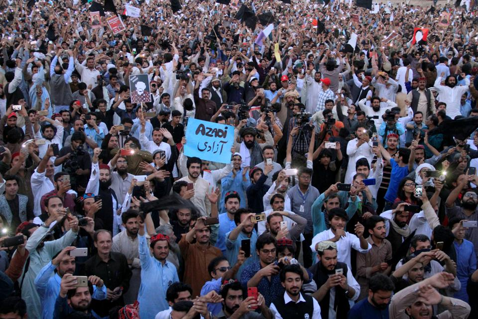 Members of Pakistan's Pashtun community chant slogans during the PTM rally in Lahore on April 22, 2018.