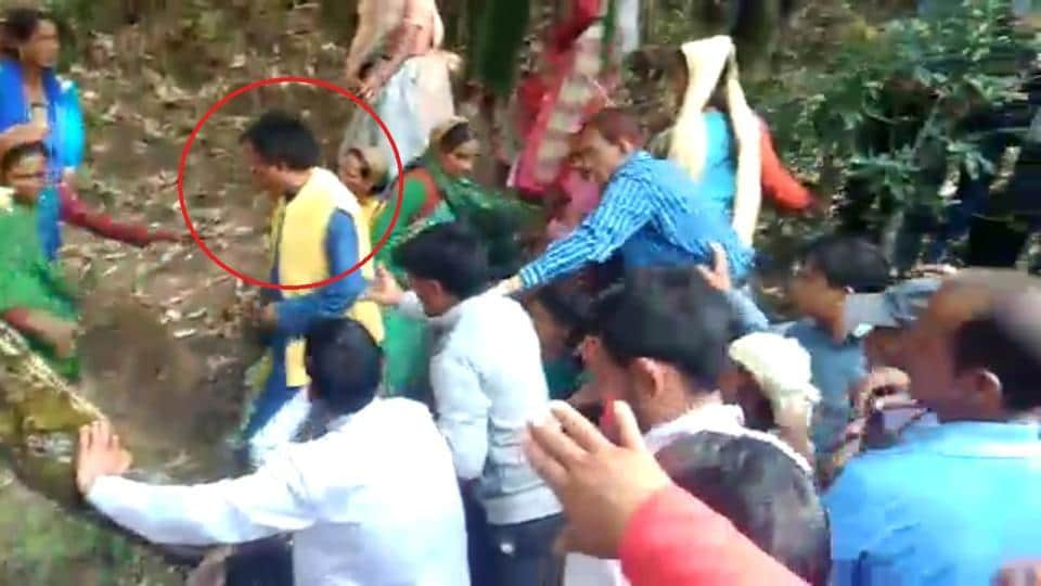 Minister Dhan Singh Rawat is seen leaving the spot in a still from the video.