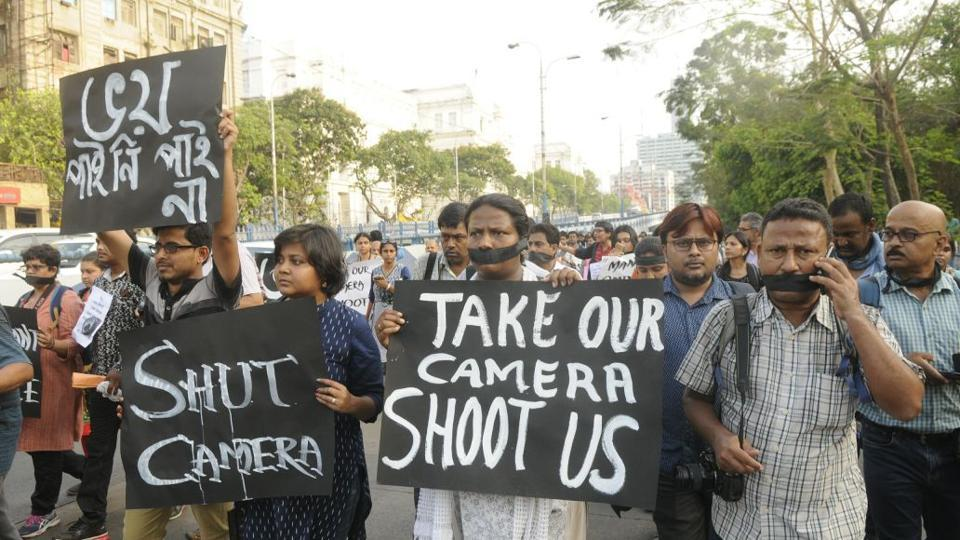Reporters and photographers at a protest rally held in Kolkata on April 11.