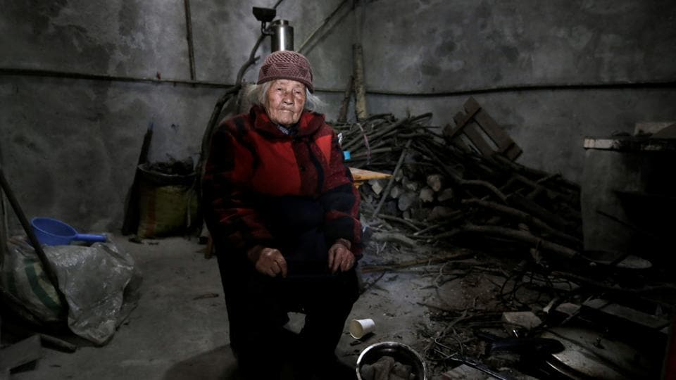 Liu Guizhen, 95, and her 106-year-old husband Wang Guanneng both survived the quake that killed their adopted son and daughter-in-law. Liu said a rock flew over her head when the quake struck as she was busy working in the fields, leaving her unscathed. Liu says she makes some money from selling eggs to tourists. (Jason Lee / REUTERS)