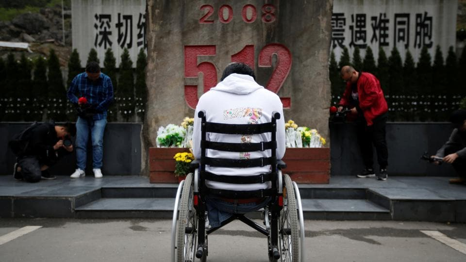 "Zheng Haiyang, now 27, lost both his legs after being buried in Beichuan Middle School, where he was trapped for more than 22 hours. ""I still feel sad now when I think of that time, but I am in a good condition now,"" Zheng said. He now works for an Internet company in Chengdu providing services to disabled people. (Jason Lee / REUTERS)"
