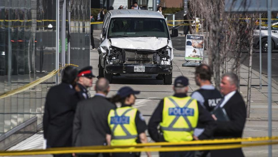 A driver deliberately plowed his white Ryder rental van into a lunch-hour crowd in Toronto on Monday, killing 10 people and injuring 15 along a roughly 1.6-km long stretch of sidewalk thronged with pedestrians, police said. (Aaron Vincent Elkaim / The Canadian Press via AP)