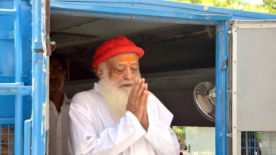 Asaram greets his supporters as he arrives for hearing at Jodhpur court.