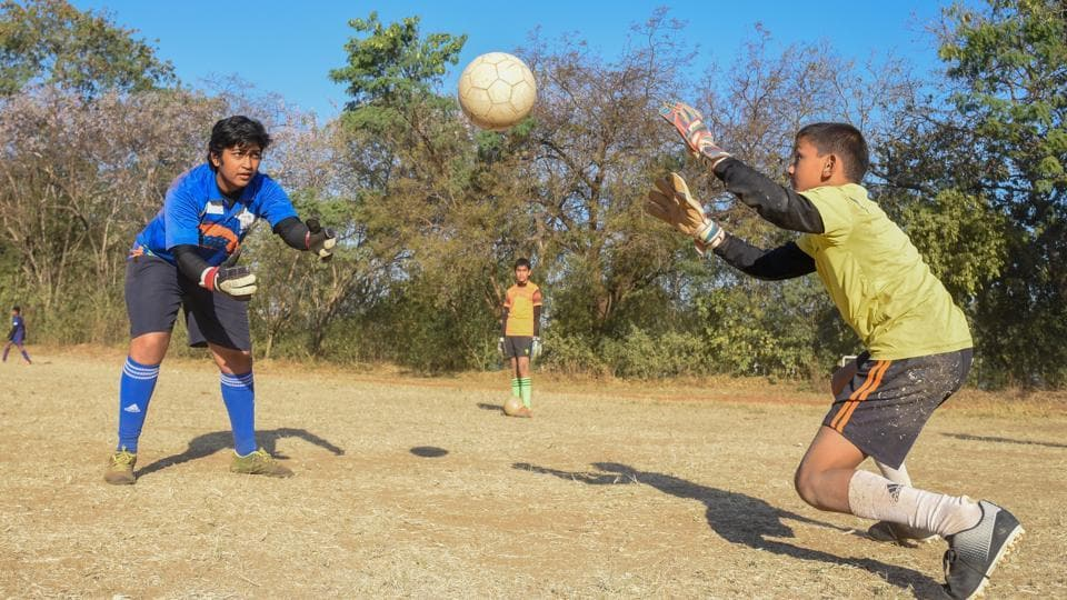 A game of football at a school in Pune. For the Playstation Generation, physical  activity can enhance health, academic performance and overall productivity