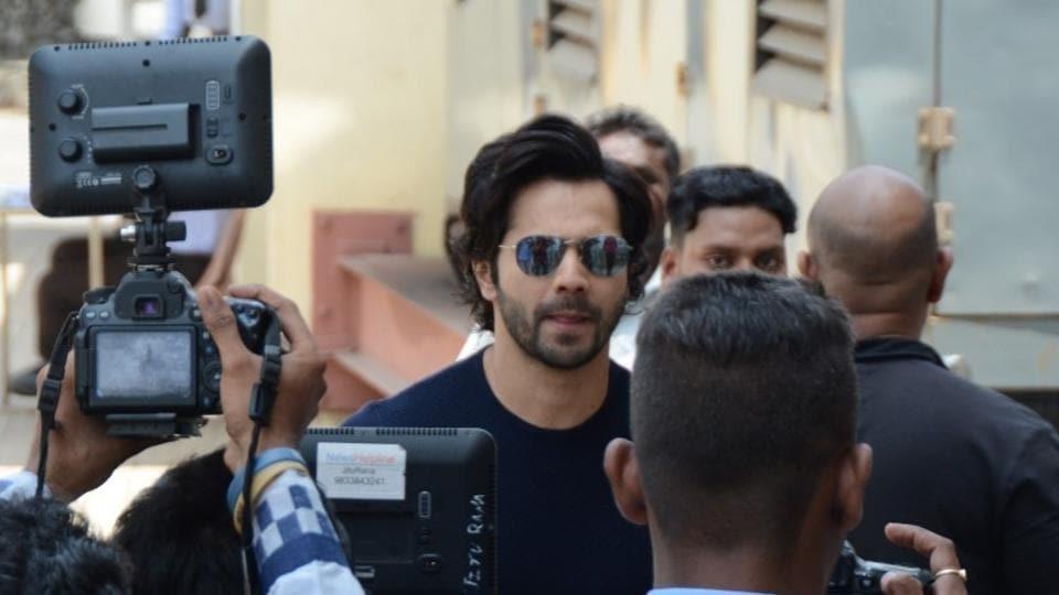 Varun Dhawan greets his fans during screening of film October in Mumbai on April 13, 2018.