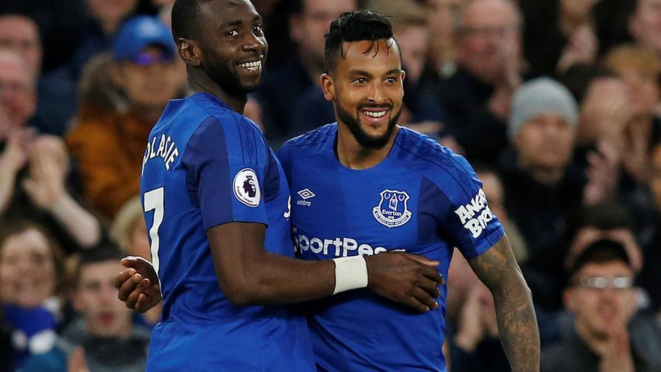 Everton's Theo Walcott celebrates with Yannick Bolasie after scoring against New Castle United in their Premier League match on Monday.