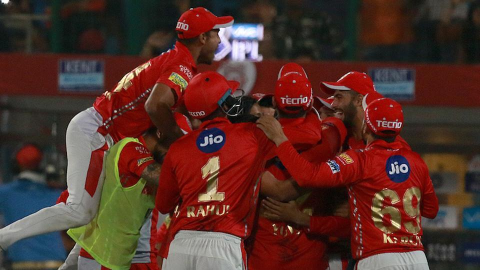 Kings XI Punjab players celebrate after beating Delhi Daredevils in their 2018 Indian Premier League (IPL 2018) match at the Feroz Shah Kotla in New Delhi on Monday. Daredevils, chasing a modest KXIP total of 143, fell short by 4 runs in the final over after Mujeeb Ur Rahman picked up the wicket of Shreyas Iyer on the last ball.    (BCCI)
