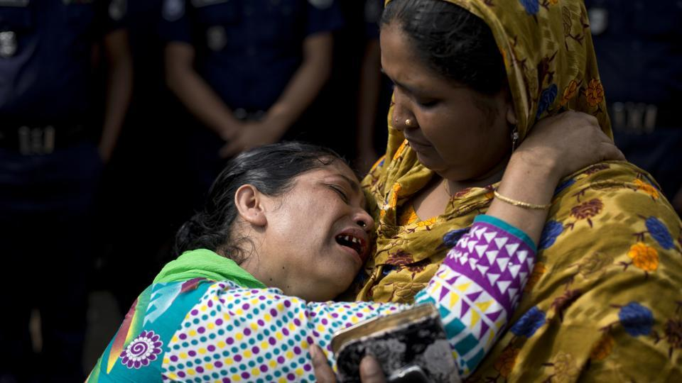 A relative of a victim of the Rana Plaza garment factory collapse cries during a protest. Hundreds of Bangladeshi citizens staged protests and paid tearful tributes at Rana Plaza on Tuesday in Dhaka, marking the fifth anniversary of one of the world's worst industrial disasters, when a textile factory complex collapse killed at least 1,130 people and left thousands injured. (A.M. Ahad / AP)