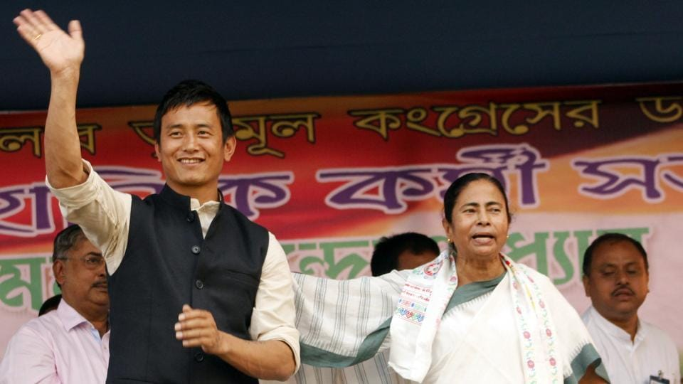 Former Indian football captain and Darjeeling Lok Shaba candidate from Trinamool Congress, Bhaichung Bhutia, with West Bengal chief minister Mamata Banerjee during an election rally in Siliguri on March 25, 2014.