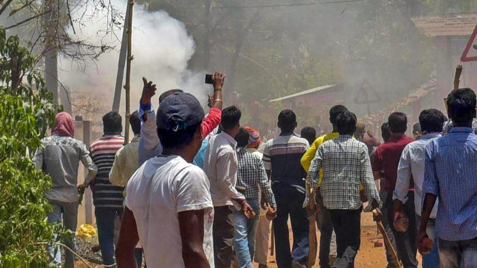 Trinamool Congress and BJP activists clash at Karidhya village in Birbhum district of West Bengal on April 23.