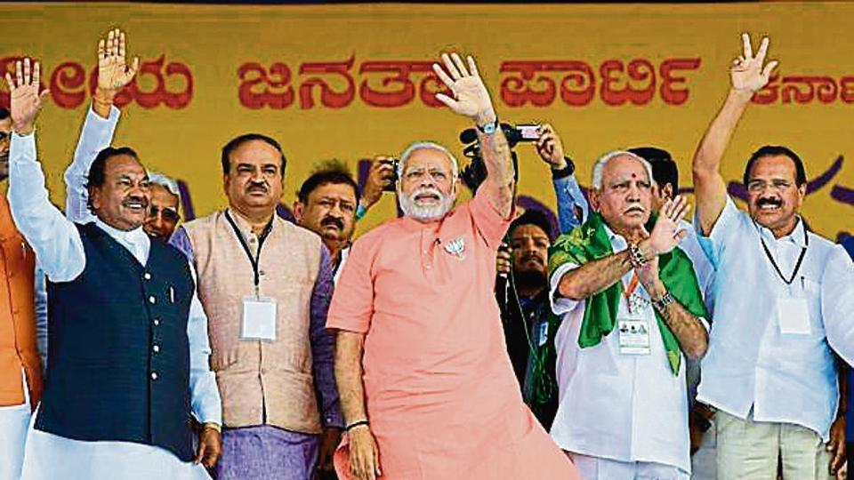 PM Narendra Modi with BJP's CM candidate BS Yeddyurappa and other leaders at an event in Davanagere in Karnataka.