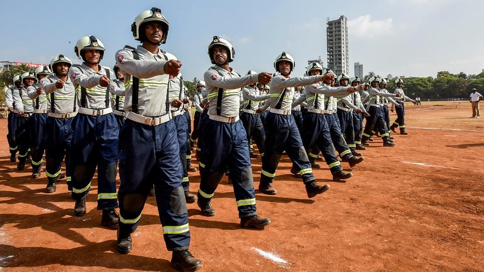 Fire fighter personnel march along. The governor of Maharashtra addresses the public at the event every year.  (Kunal Patil/HT Photo)