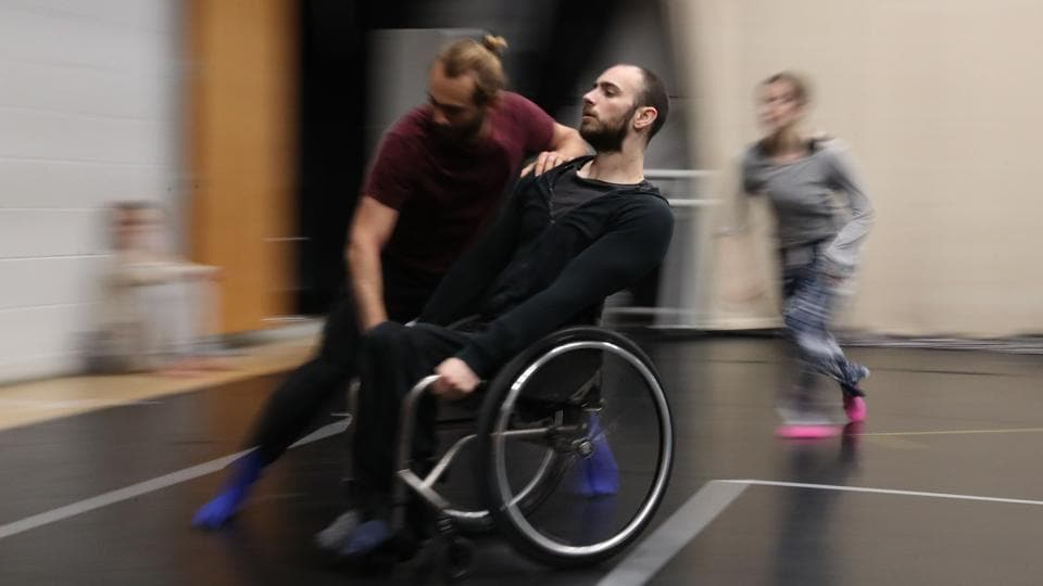 """The diversity of our physicalities is how we make something new,"" said Joel Brown, a wheelchair user who is one of the group's four disabled dancers. He was paralysed from the chest down after a car crash at the age of nine and, as a result, finds it hard to keep his balance without the use of his stomach muscles. (Antoine Pollez / AFP)"