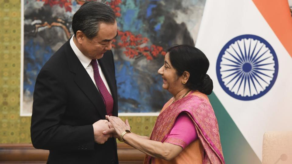 Indian Foreign Minister Sushma Swaraj (R) and Chinese Foreign Minister Wang Yi share a moment before a press conference, following their meeting at the Diaoyutai State Guest House in Beijing, China on April 22, 2018. (Madoka Ikegami / AP)