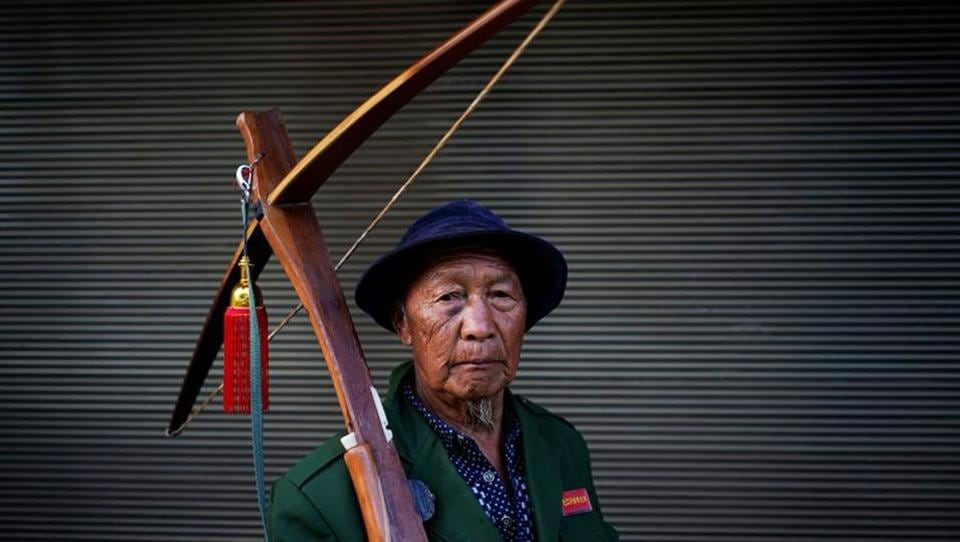 An ethnic Lisu man poses with his crossbow during a crossbow shooting competition in Luzhang Township, China. In a country that often bans the sale of kitchen knives during political summits, it's still normal to see ethnic Lisu openly carrying the weapon in public.  (Aly Song / REUTERS)