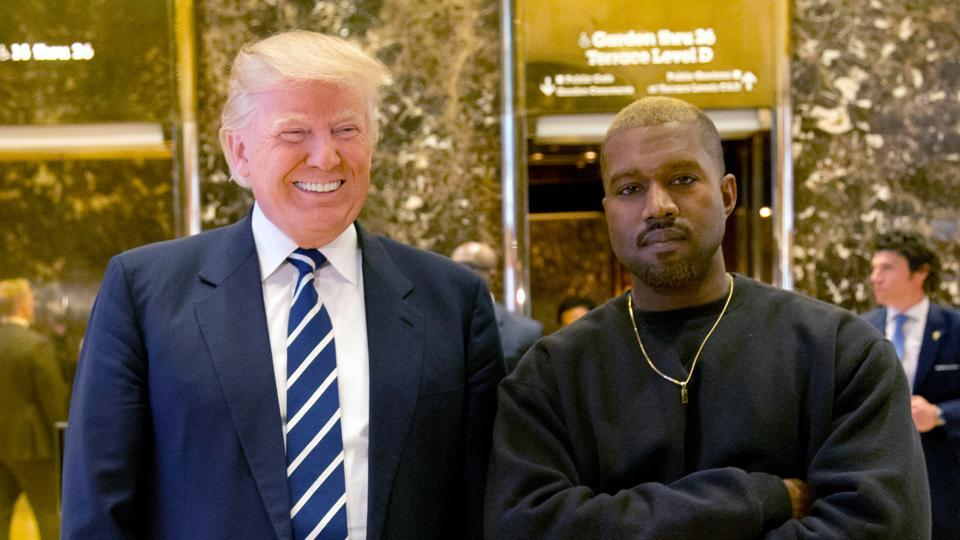 Donald Trump and Kanye West pose for a picture in the lobby of Trump Tower in New York.
