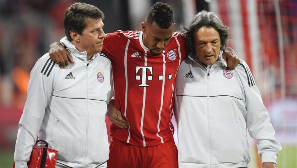Bayern Munich's German defender Jerome Boateng (C) walks off the pitch after getting injured during the UEFA Champions League semi-final first-leg football match FC Bayern Munich v Real Madrid CF in Munich on April 25, 2018.