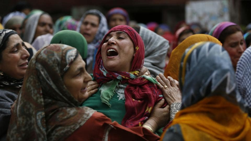 An unidentified relative of slain political worker Ghulam Nabi Patel breaks down during his funeral at Dangarpura, Jammu and Kashmir on April 25, 2018. (Mukhtar Khan / AP)