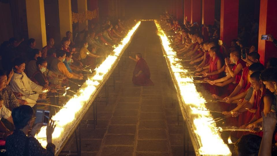 Members of Tashi Lhunpo Monastery and Students for a Free Tibet light candles on the birthday of 11th Panchen Lama as they attempt the world record  for most lit candles on a birthday cake at the Tashi Lhunpo Monastery in Karnataka on April 25, 2018. (Tenzin Kalden / AP)