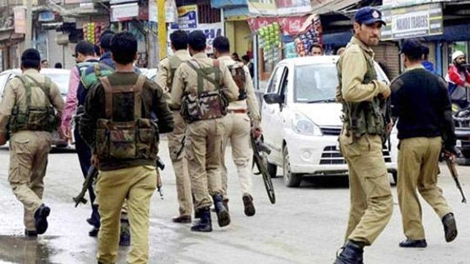 Personnel of the Jammu and Kashmir Police search for militants.